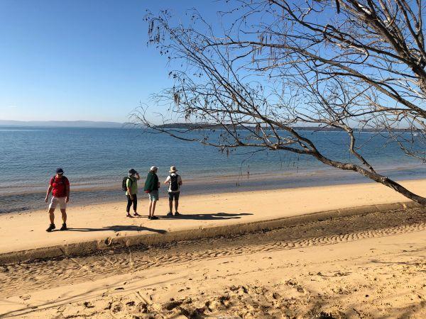 Women hiking the beach