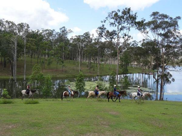 Riders near lake - Image courtesy of Slickers